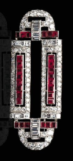 AN ART DECO RUBY AND DIAMOND BROOCH, CIRCA 1925. The geometric openwork plaque, set with old European and baguette-cut diamonds, accented by calibré-cut rubies, mounted in platinum. #ArtDeco #brooch