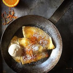 A Suzette crepe is a French dessert made with a Suzette buttercream, a sauce made with caramelized sugar and butter, mandarin or orange juice, zest and liqueur Grand Marnier or Curaçao.