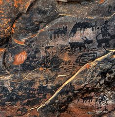 Pictographs--  the Outlaw Trail today in the Red Canyon Valley of Sedona in the Coconino National Forest.  The trail was very scenic with great view of the red rock cliffs.  These beautiful red cliffs still house the Indian ruins of settlement long lost.