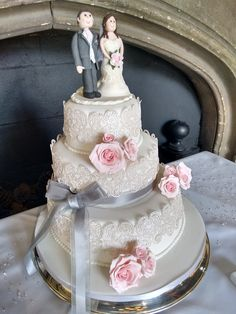 Vintage edible lace, handmade roses and personalised bride and groom topper. www.truly-scrumptious-events.co.uk