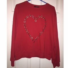 Forever 21 Red Sweater This is a red sweater, size Medium, has been worn a few times, bought at the Forever 21 store. The heart is see through, I usually wore a bandeau or tank top underneath. Forever 21 Sweaters
