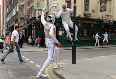 Members of the Great Britain and Poland Fencing Teams pose for pictures in appropriately named streets in London to promote their forthcoming exhibition contest Christopher Lee/Getty Images