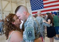 Private Andrew Rapp of the Arizona Army National Guard shares a moment with his wife, Christina Rapp of Ithaca, N.Y. after seeing each other for the first time during a homecoming of the Arizona Army National Guard's E Company 29th Brigade Support Battalion at the Arizona Army National Guard hangar near Sky Harbor International Airport in Phoenix on Thursday, September 24, 2009. The Arizona Army National Guard's E Company 29th Brigade Support Battalion had been in Iraq since November 2008…
