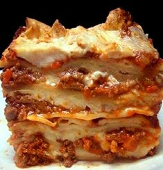 Recipe for Lasagna Bolognese - Who doesn't love a thick, steaming hunk of perfectly textured pasta sheets, layered with a well seasoned combination of ricotta cheese, herbs and seasonings..