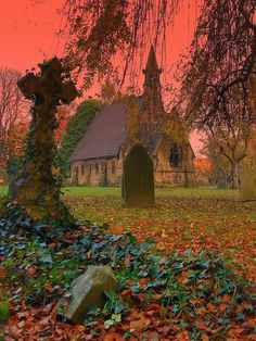 Rosy hued sunset at a romantic country churchyard in the English countryside, Atherton, England.