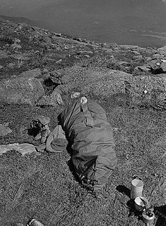 Icy blasts can blow atop Mount Washington, up in the cold above the Timberline, but Nurse Lt. Beulah Greenwalt, of Rolla, Missouri is as snug as the proverbial bug in a rug, as she tests the sleeping bag of the Army's latest wet-cold-windy climate outfits. Lieutenant Greenwalt who was a prisoner of the Japs for 33 months after capture at Corregidor was one of fourteen army Nurses testing the outfits for foreign service.