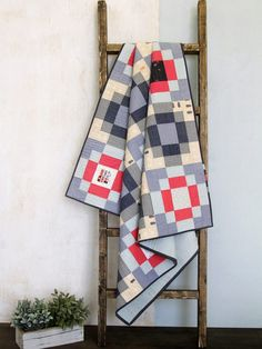 The Checkered Streets Baby Quilt designed by Art Gallery Fabrics is a contemporary take on the traditional Antique Tile quilt block. Find the full tutorial at WeAllSew. Big Block Quilts, Lap Quilts, Mini Quilts, Quilt Blocks, Scrappy Quilts, Baby Boy Quilt Patterns, Baby Boy Quilts, Quilt Patterns Free, Free Pattern