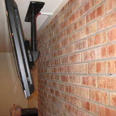 Ceiling Installation of a TV above a brick fireplace | Yelp