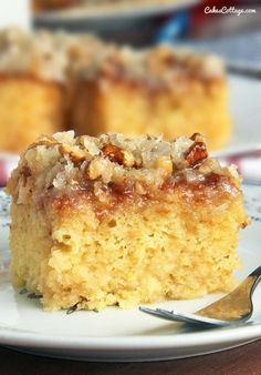 "DO NOTHING CAKE - 2 c. sugar; 2 eggs; 1 tsp. vanilla; 16 oz. crushed pineapple, undrained; 2 c. flour; 1 tsp. baking soda. ICING: 1/2 c. butter; 1 c. sugar; 3/4 c. evaporated milk; 1 c. coconut; 1 c. nuts; 1 tsp. vanilla. CAKE: Blend first 6 ingredients in a bowl. Pour into 13""x9"" cake pan. Bake 350°F 35-40 mins. ICING: Mix butter, sugar & milk together. Cook over medium heat until a little thickened. (about 5 mins. at a boil). Remove from heat Add remaining ingredients. Pour over hot cake."