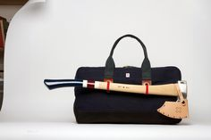 I want one but will replace the axe with an umbrella.  Not quite as rufty-tufty but more practical on my daily commute.