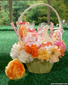 Paper Flower Basket--Decorate with DIY paper flowers that can be reused as an arrangement or to decorate packages.   Like the idea of recycling basket parts.  Flower directions from Martha Stewart.