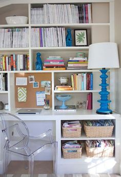 Love the use of a lucite chair at the desk. Check out My Chic Nest's Clara chair for your own study.