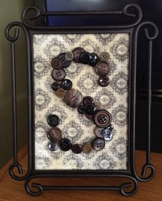 Button art-like the idea of black buttons on black printed background-just not this one