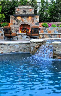 Luxurious mediterranean stone wall pool with patio furniture with outdoor fireplace with stone fireplace and stone pool trim. Outdoor chair pool with water feature with hot tub., 29 designs in Pool Waterfall Ideas gallery Pool Spa, Outdoor Swimming Pool, Backyard Pools, Indoor Pools, Backyard Beach, Lap Pools, Backyard Retreat, Beach Pool, Best Swimming Pools