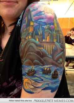 Tattoo of Hogwarts castle with first years on the lake.