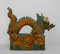 Pair Of Chinese Ming Dynasty Dragon Roof Tiles | From a unique collection of antique and modern ceramics at https://www.1stdibs.com/furniture/asian-art-furniture/ceramics/