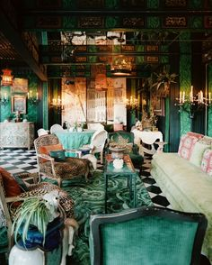Yes!  Malachite wallpaper AND a malachite rug.  In the magical world of Tony Duquette, more is more!