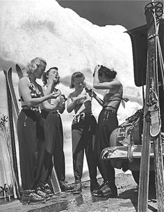 Women putting on suntan lotion before summer skiing session at Lassen Volcanic National Park, California.  Photo by Peter Stackpole, 1942