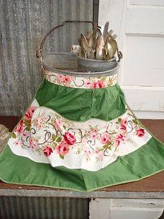 An apron on an old bucket, so cute !