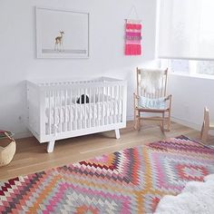 NURSERY / / In love with this beautiful Turkish Kilim rug, with all the other nursery features kept simple in white and timber, including that gorgeous vintage rocking chair. Peaceful and stylish. @sarahrodesign via @babyletto