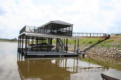 3 Slip, 2 Story Floating dock with screened in room.