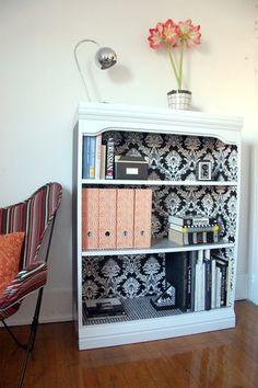 Fancy up a regular bookshelf with wallpaper on the inside.Very cute idea.