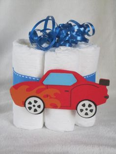 Mini diaper cake race car, great decoration, baby shower or new baby gift.. $7.25, via Etsy.