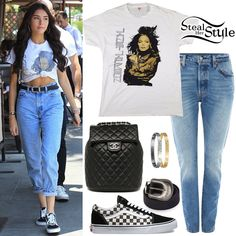 Madison Beer was spotted leaving Il Pastaio in Beverly Hills wearing a Vintage 90s Janet Jackson T-Shirt ($39.99), Levi's 501 Skinny Jeans ($148.00), a Chanel Lambskin Quilted Backpack ($5.162,65), Cartier Love Bracelets in Yellow Gold ($6,300.00) and White Gold ($6,750.00), a belt like this from Topshop ($30.00) and Vans Checkerboard Old Skool Sneakers ($60.00).