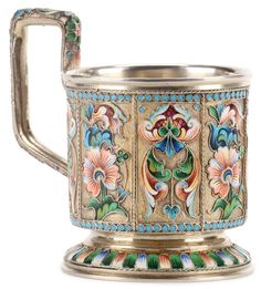 A RUSSIAN SILVER GILT, SHADED, AND CLOISONNE ENAMEL TEA GLASS HOLDER, MOSCOW, 1896-1908.  The sides divided into eight panels displaying shaded enamel florals against a stippled, gilt ground. The handle similarly decorated and with turquoise beading, underside with Cyrillic maker's mark EP.