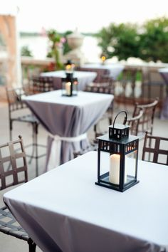 Cocktail Tables with Lanterns to save on flowers