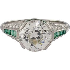 Art Deco platinum diamond and emerald engagement ring. The open work setting is set with 1 European cut diamond, that weighs approximately Art Deco Ring, Art Deco Diamond, Art Deco Jewelry, Estate Engagement Ring, Vintage Engagement Rings, Antique Jewelry, Vintage Jewelry, Art Deco Period, European Cut Diamonds