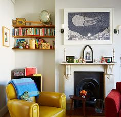 Credit: Jan Baldwin The usual rules of colour don't apply to this three-bedroom maisonette. Oranges, reds and yellows feature prominently, s...