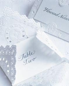 Envelopes made from folded square doilies contain special missives for your guests -- their reception seating cards.