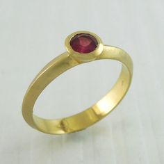 Ruby engagement ring in 18K goldalternative gold by mbfjewelry