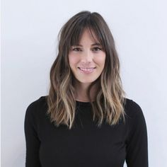 Your on-trend lob snags even more style points with long, middle-parted bangs that blend into beachy waves. Hairstylist Anh Co Tran of the cult Ramirez Tran Salon created this mid-length look. Image: @anhcotran
