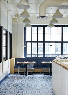 Artistic Tile's porcelain Hydraulic Blue Matte installed at One Girl Cookies in Industry City, Sunset Park, Brooklyn