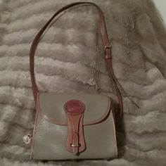 ⚡SALE⚡Vintage Dooney & Bourke Purse Authentic, Vintage Dooney & Bourke Purse - All-Weather Leather, Adjustable Shoulder Strap, Gold Toned accents (even on bottom), Dooney & Bourke Charm hangs along 1 side, 3 compartments inside - I zipper, 1 that snaps & 1 that's open,  a couple of stains inside - that is not one big stain - it's a shadow, you can see the small stains are the small ones in the right in the picture - see last picture, very little wear (noone would see unless you was to show…