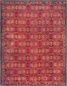 A Swedish Pile Rug with exquisitely blended colors reading as cool reds and mauves. An allover modern abstract design within a color blocked border.