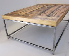 "The Ripley coffee table is simple and refined. The combination of reclaimed wood and welded 3/4"" square tubing, will add an industrial modern feel to any room you put it in. Shown with a 12-step natural satin finish and semi-brushed steel gives this table the perfect mixture of warm and cold. Hand made in Colorado."