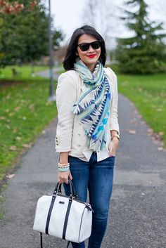 Cream tweed blazer with cream blouse, navy and white scarf, spiked bracelet