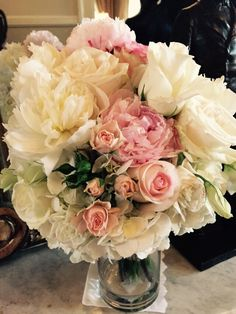 Hydrangeas, peonies, and roses make up this beautiful bride's bouquet.