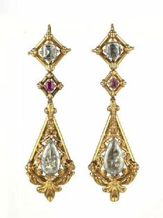 This earring, part of a demi-parure that includes another earring and a brooch, is the type of fashionable jewellery made in the 1850s. The gold has been stamped with relief decoration to give the impression of being more substantial than it really is. Before the discovery of rich gold deposits in California in the 1860s, the metal was very highly priced and such devices were employed even for pieces set with precious stones. The earring contains ruby and aquamarine  - Museum of London