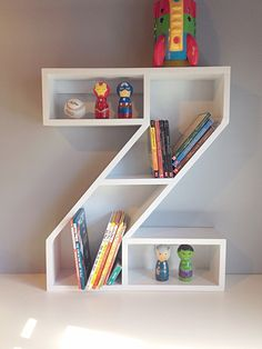 """These letter bookshelves are the perfect way to personalize your child's room. Handmade out of beautiful pine wood. This shelf ships fully assembled. Approximate Dimensions: 29""""H x 23 7/8""""W x 5 1/2""""D Width may change slightly depending on the letter. www.facebook.com/Jessieswoodworking www.twitter.com/jessieswoodwork"""