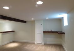 This basement was a big project. A fireplace that couldn't be used took up space in the back corner of the basement so it was taken down and the wood from the mantel made the shelving unit and the bar top. Great way to use materials you already have!
