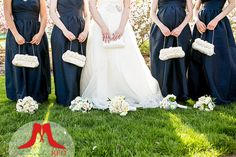 These navy blue gowns were an early spring wedding- beautiful with the cute white purses!