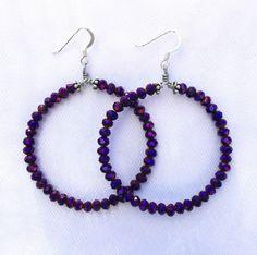 A personal favorite from my Etsy shop https://www.etsy.com/listing/466831267/purple-metallic-crystal-hoop-earrings