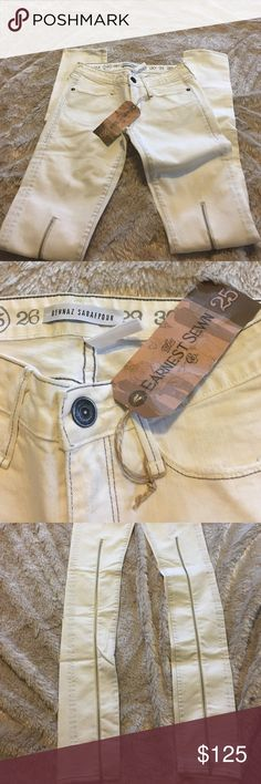 Ultra Rare Earnest Sewn/Behnaz Sarafpour 25W 35L NWT 25W 35L White Skinny Jeans with zippers running up from the bottom hem to just above the knee.  These initially sold for $395 when first marketed.  I've not been able to find any of these on sale anywhere online. These were produced from a limited collaboration.  One small mark on the thighs. This may come out with washing. Jeans Skinny