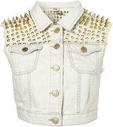 gold studs on white denim vest