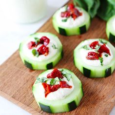 Cucumber Canapes - featuring a whipped feta and cream cheese topping. Finish with sundried tomatoes and fresh basil - See more at: http://www.ladylux.com/style/site/article/bite-size-appetizers/#sthash.4yun7Y6R.dpuf