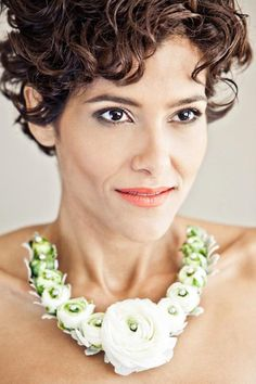 For the bride who will dare to be different - look at this lovely necklace made of fresh white ranunculus - by Datura in Connecticut.